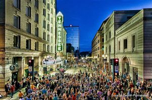 Hundreds gather on Gay Street for the relighting of the marquee and vertical sign on August 31, 2016. (Photo by Bruce McCamish Photography)